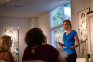 Jen Aly teaching speaking money mindset business coach