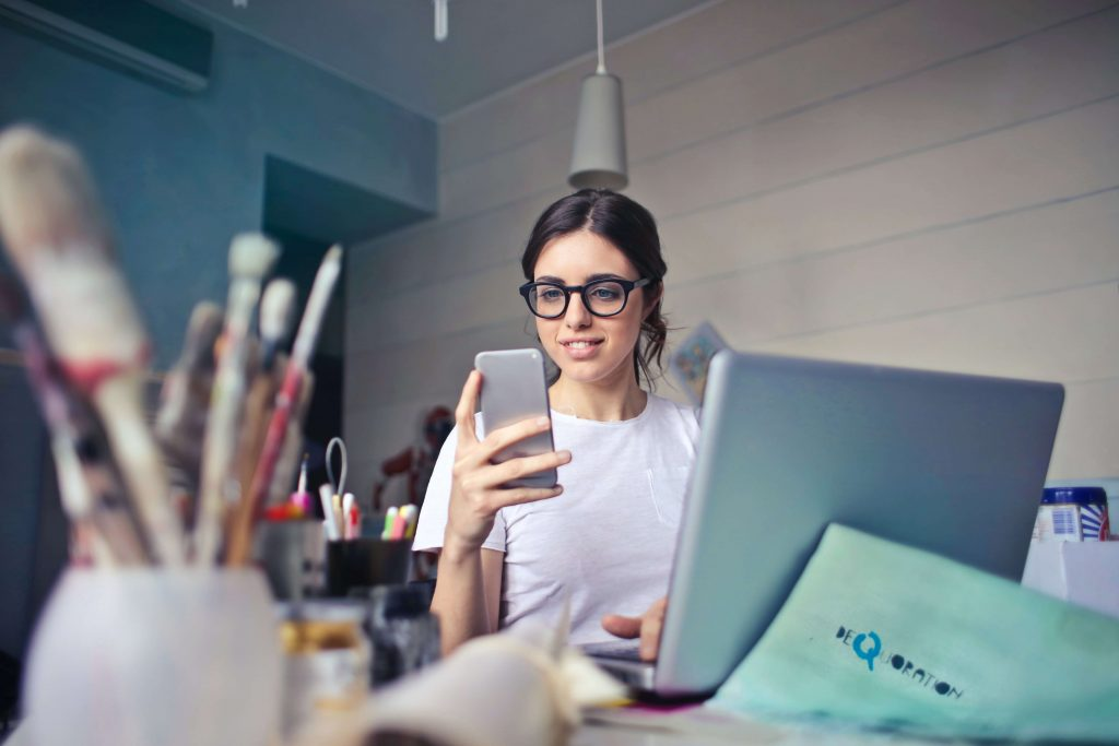 Young female entrepreneur creative business owner with laptop at desk